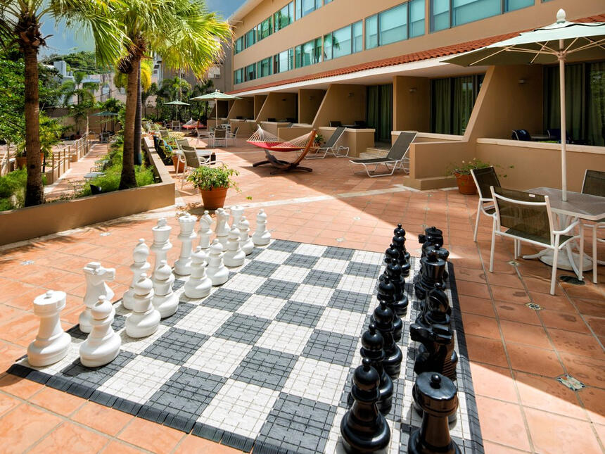 oversized chess board and chess pieces
