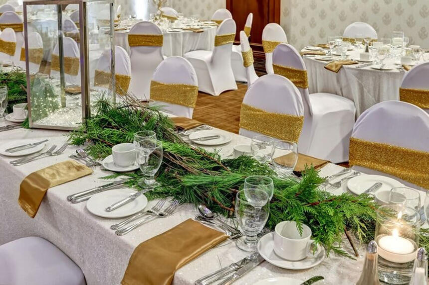 hall for weddings with white & gold theme at Inn of Waterloo
