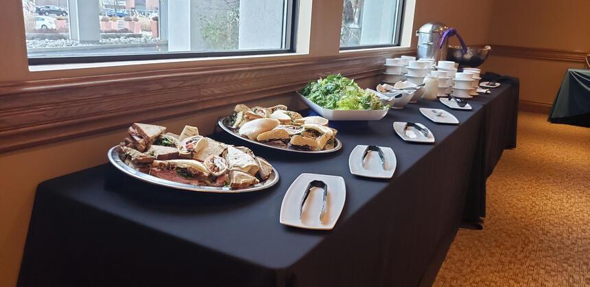 Sandwich Boards in a table near window at The Inn of Waterloo