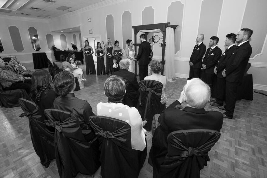black & white image of wed ceremony at The Inn of Waterloo