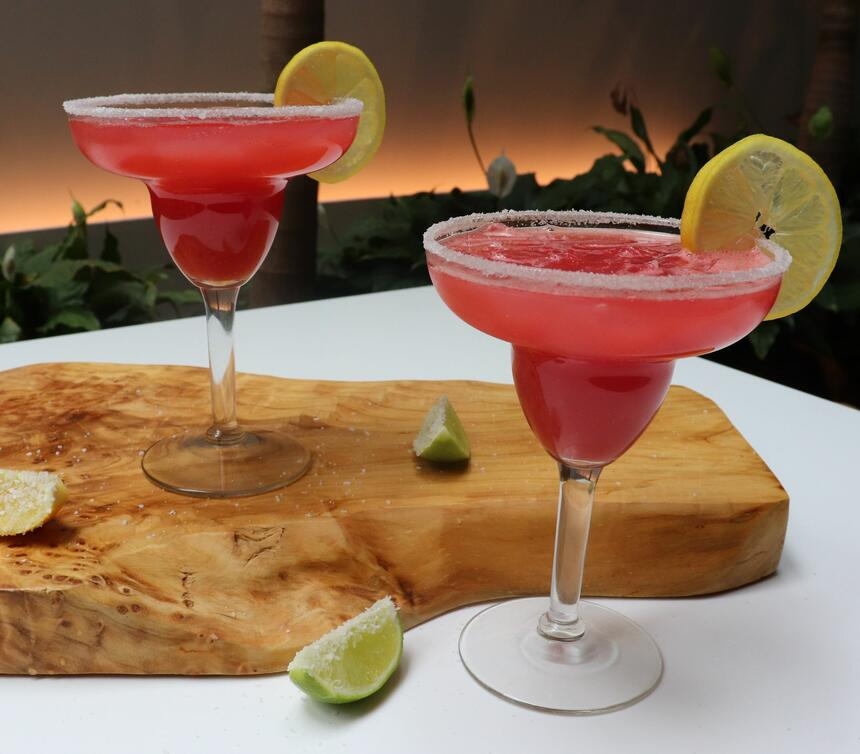 two cocktail drinks on table