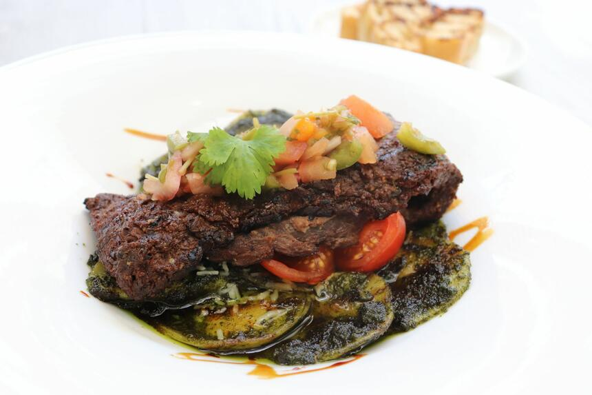 artfully plated steak and vegetables