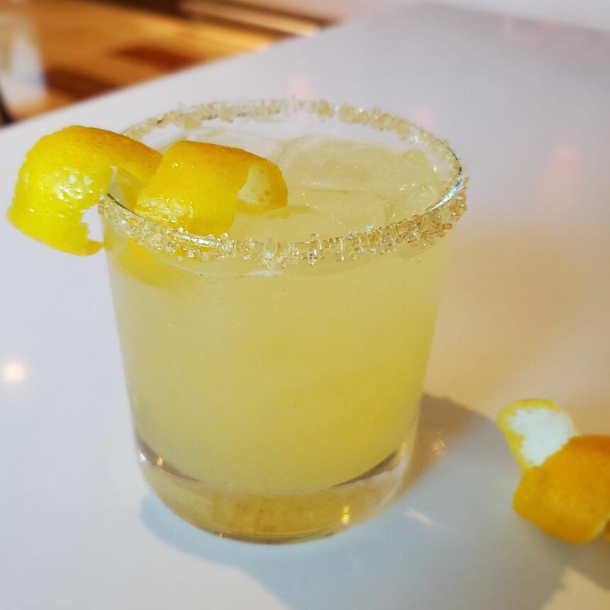 lemon cocktail drink with lemon peel