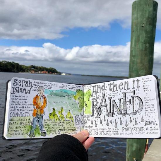 Someone holding Book named Sarah Island at Gordon River Cruises