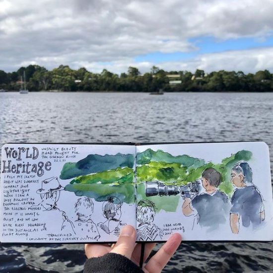 Chapter of World Heritage on the book at Gordon River Cruises