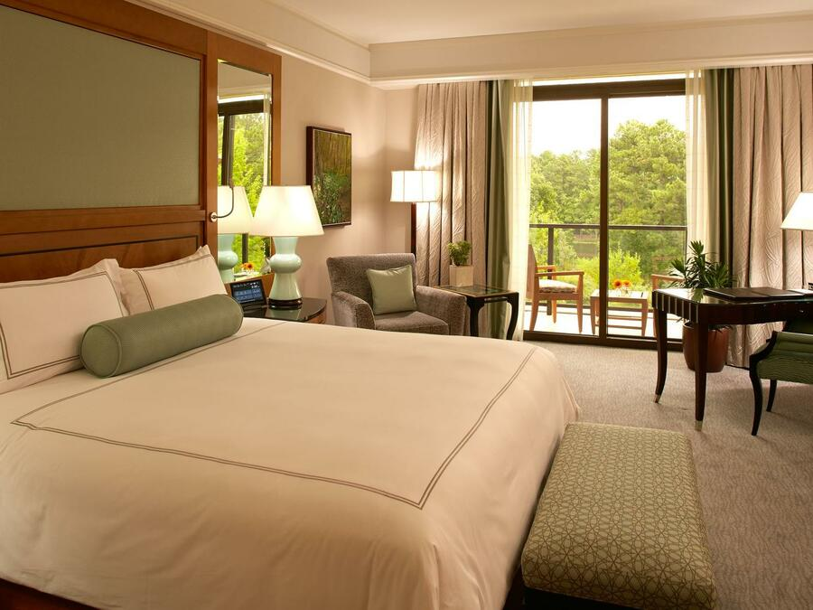 bed in hotel suite with window view