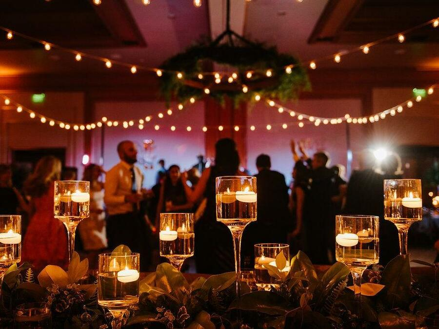 close up of candles during reception - Caroline Lima