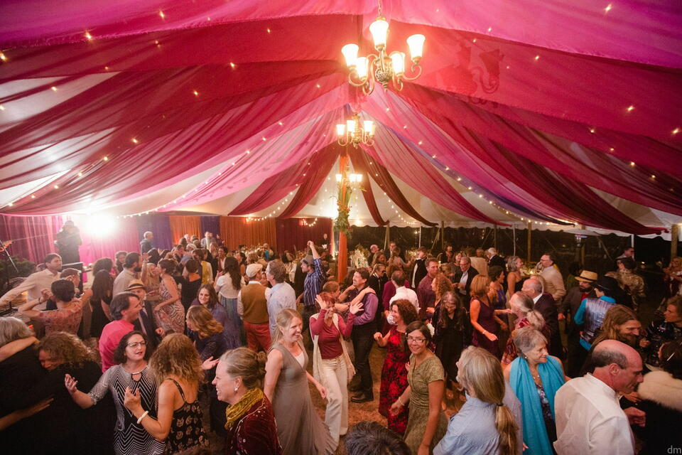 People dancing outdoor barn tent at The Heritage House Resort
