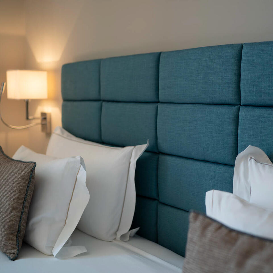 Cusioned headrest of a bed-Grand Hotel Portovenere