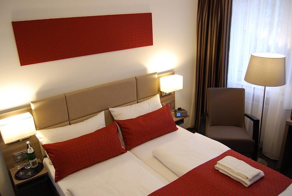 Double beds- Dom Hotel Am Roemerbrunnen