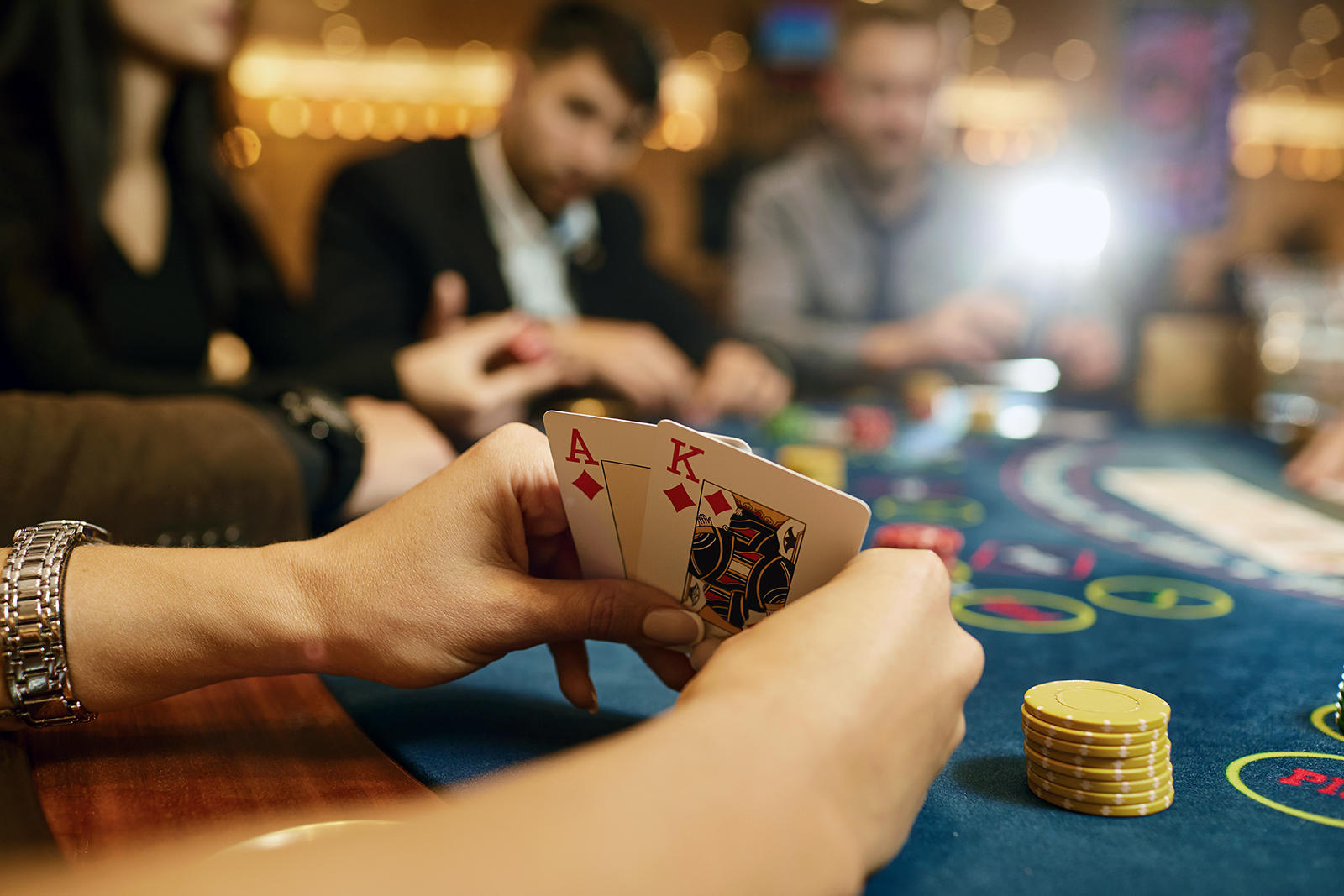 Close up of hands at Blackjack table