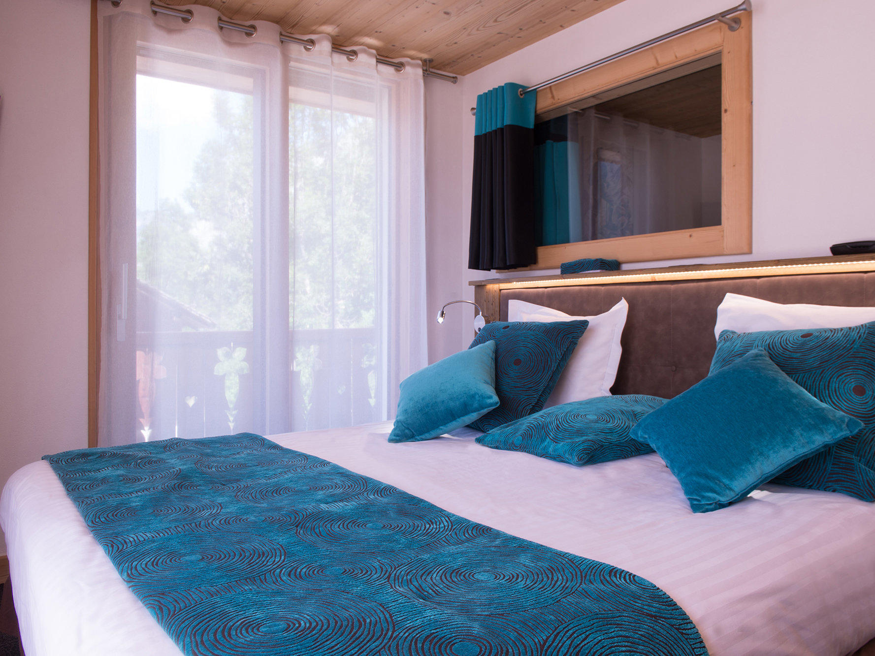 Bed in Connecting Family Room at Hotel Gentianettes, The Originals Relais