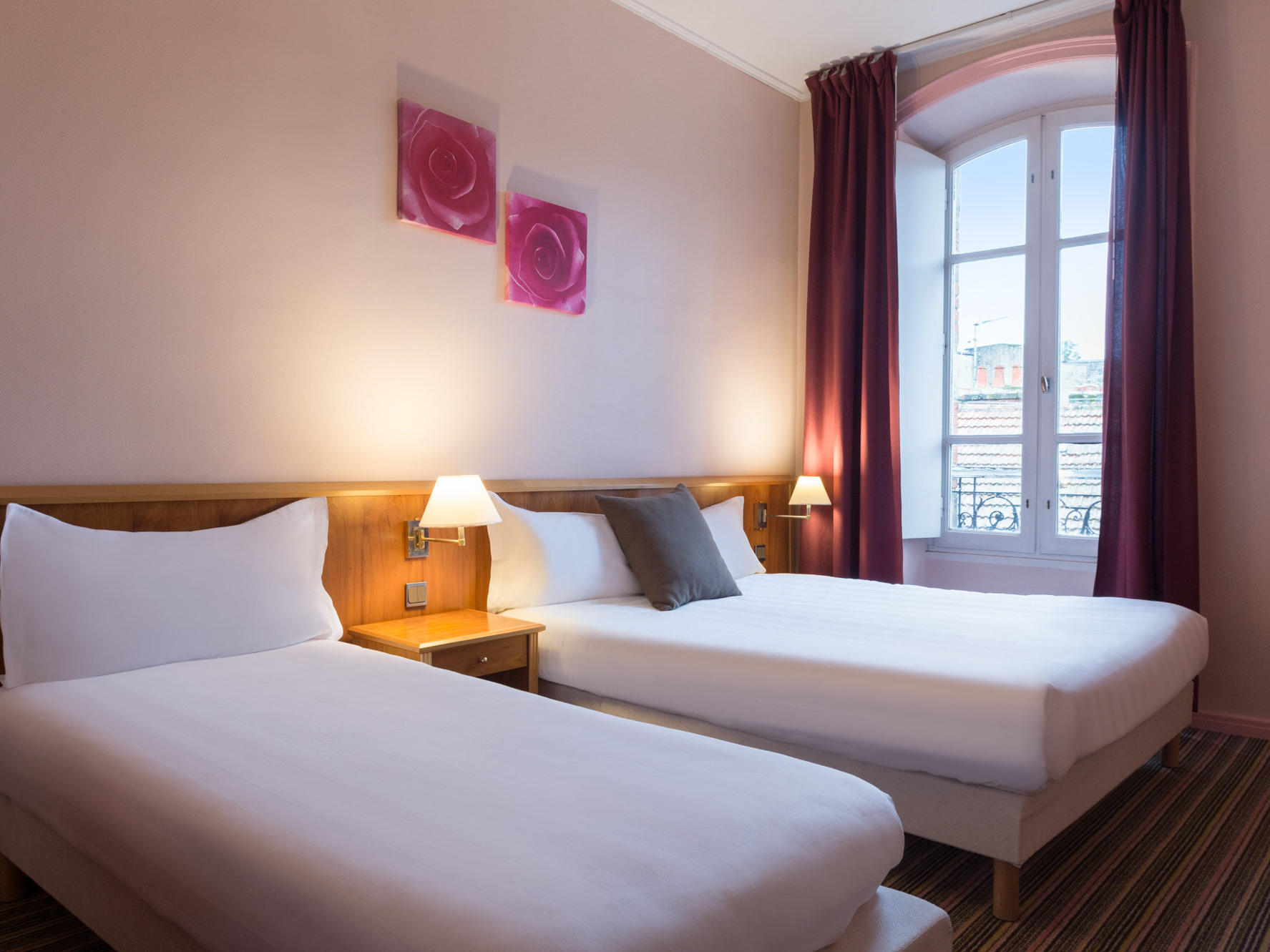 The Superior Family Room at the Grand Hôtel Saint-Pierre with one large double bed and one single bed