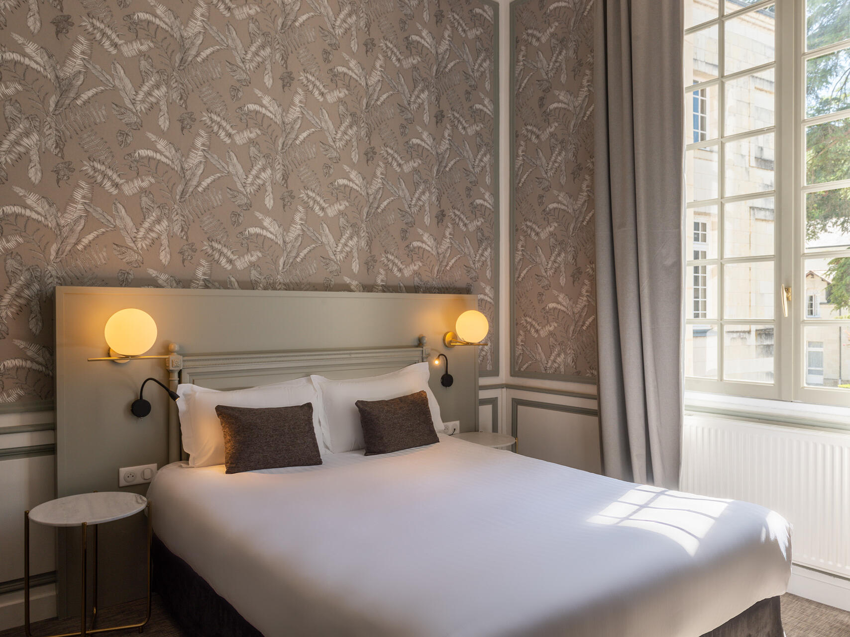 Double bed in chambre classique at The Originals Hotels