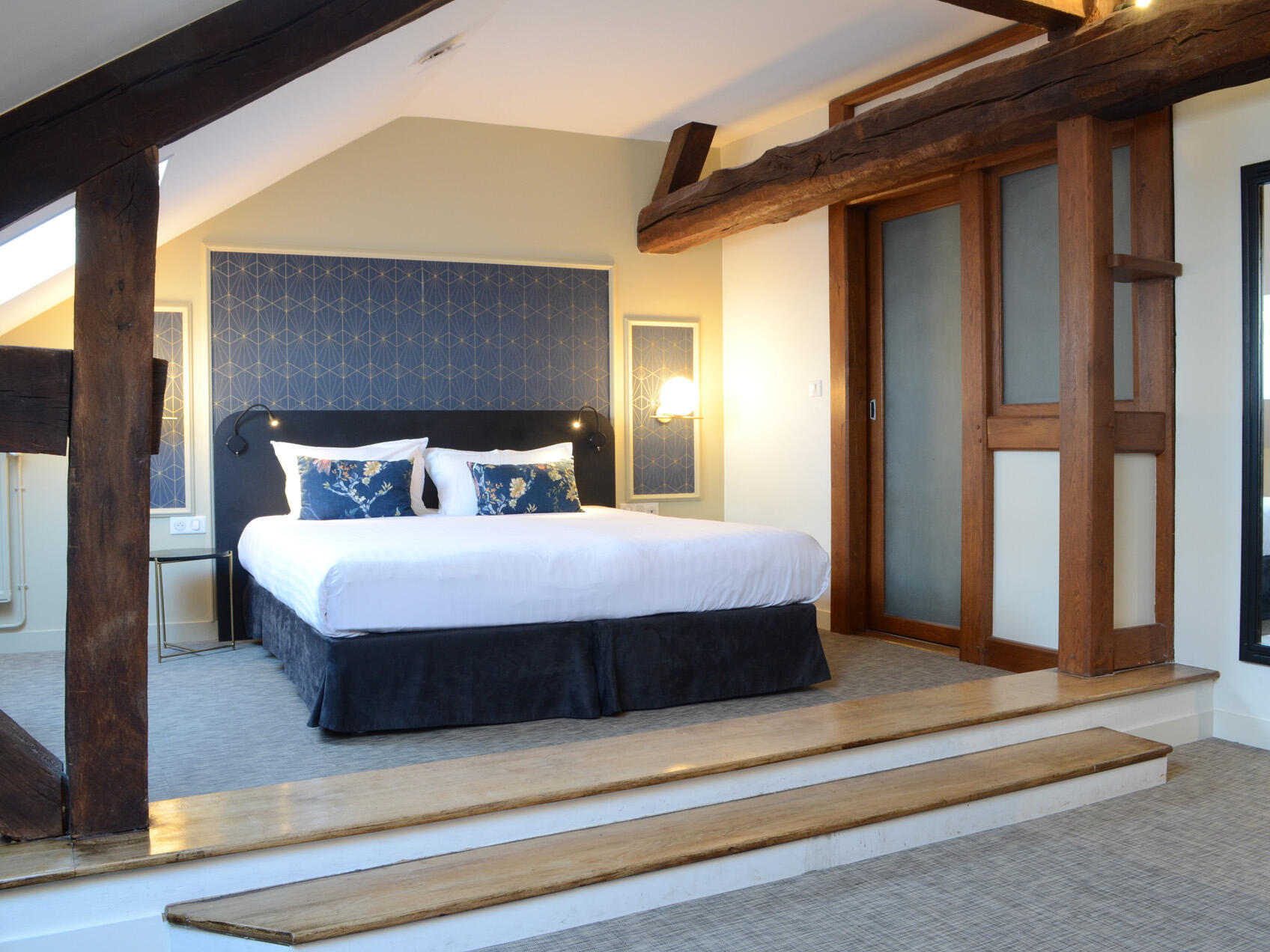 Interior of chambre familiale mansardee at The Originals Hotels