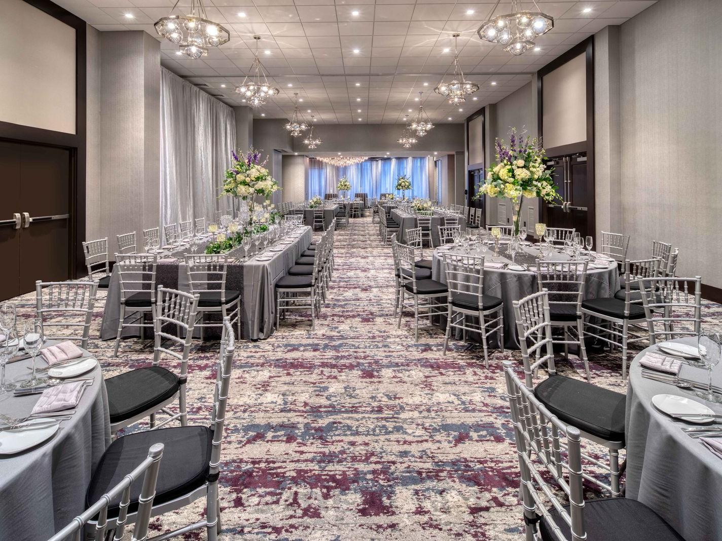 banquet room with grey linen top tables and chairs