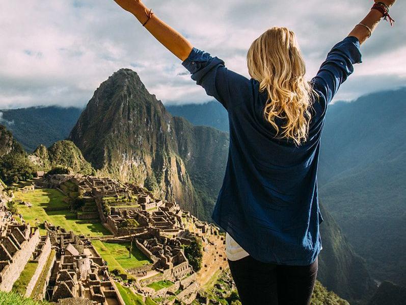 A girl on top of Machu Picchu Mountain at Hotel Sumaq
