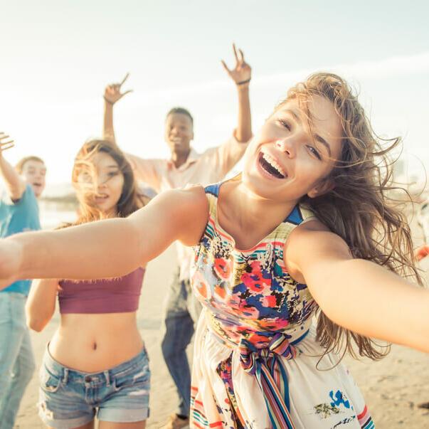 People enjoying at the beach near Be Fremantle