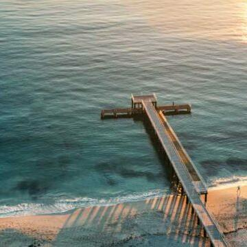 Aerial view of the pier at the beach near Be Fremantle