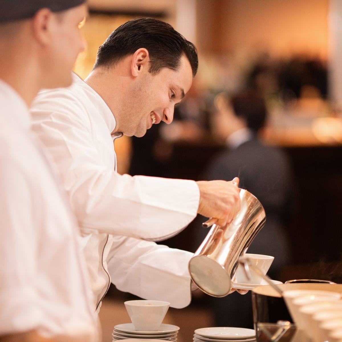 chef pouring coffee
