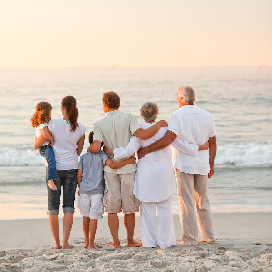 Multigenerational Family on the beach at dusk