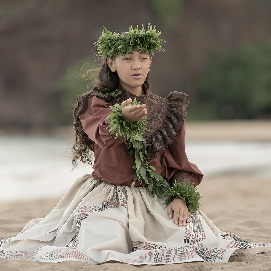 hawaiian female wearing lei on beach