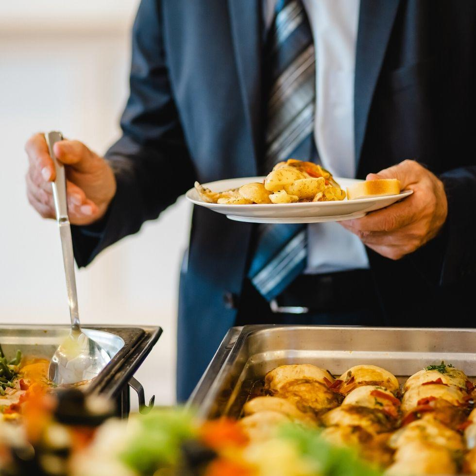 Gentleman in a tie at a buffet.