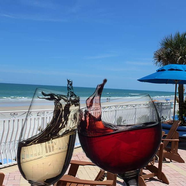 red and white wine in wine glasses being toasted overlooking the Atlantic Ocean, Daytona Beach, Plaza Resort and Spa, Seabreeze Terrace