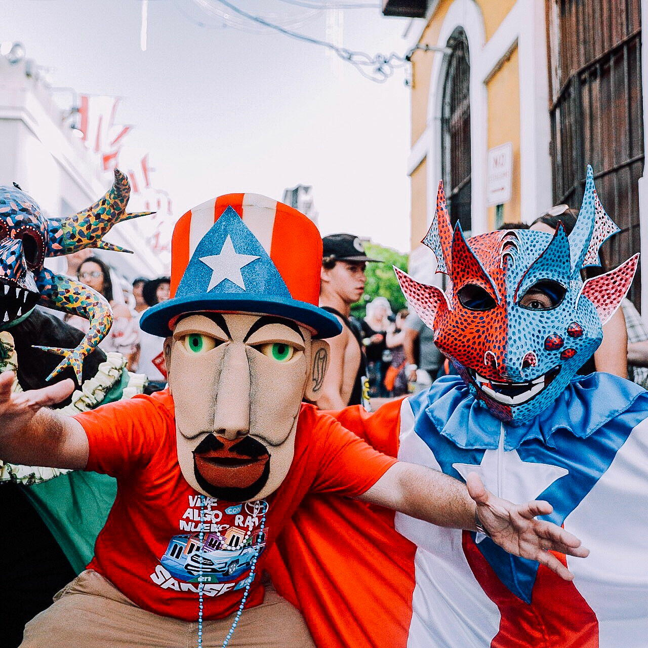 Festival of Calle San Sebastian with people in masks and costumes