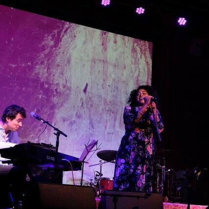 woman singing man on piano
