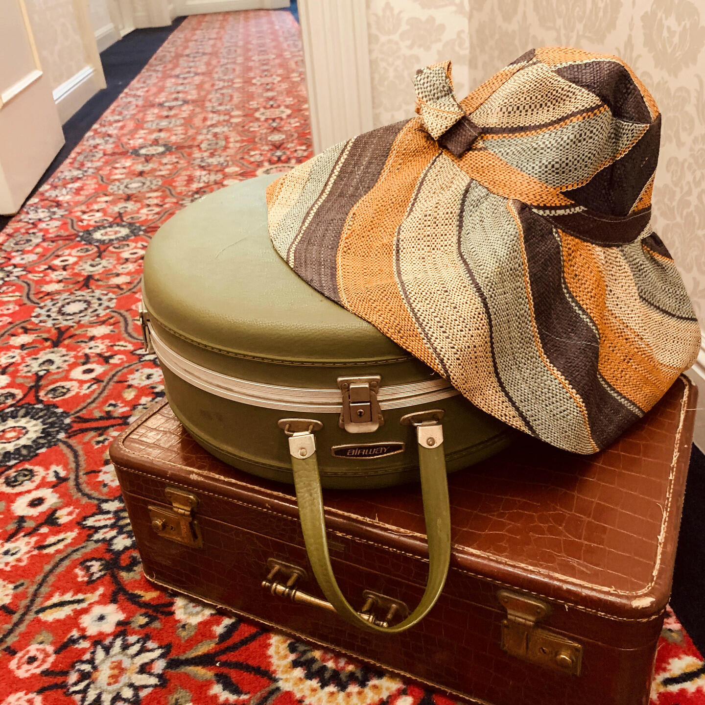 two suite cases and a hat
