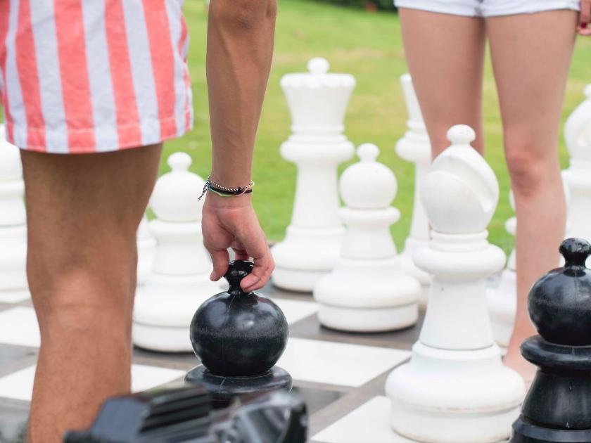Outdoor chess game at Fiesta Resort