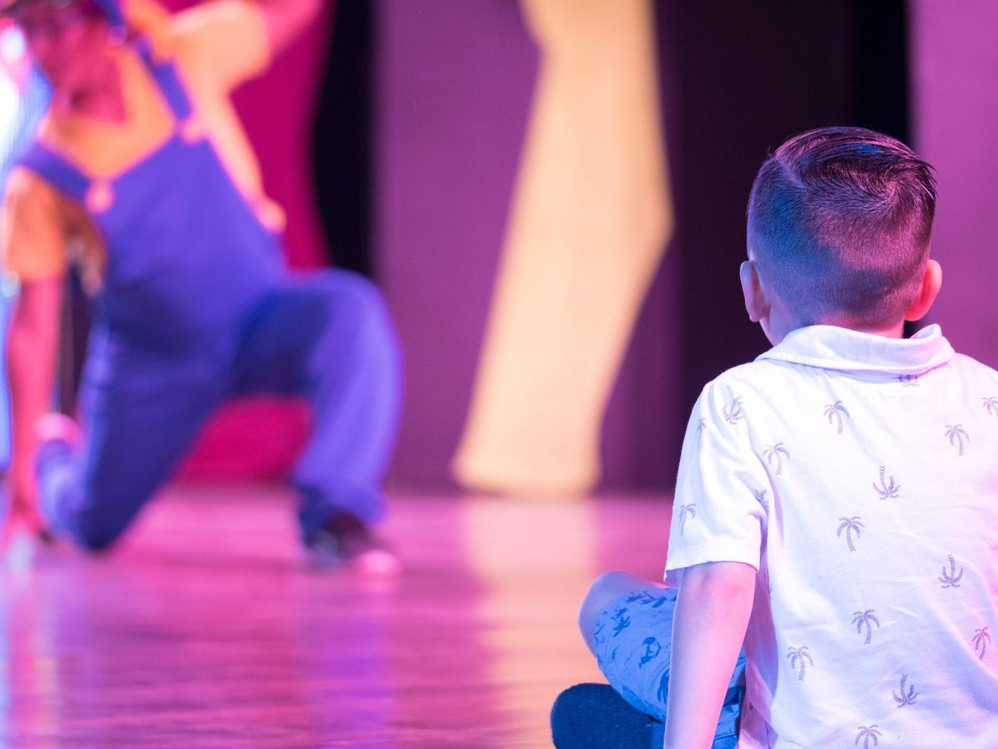 Enjoying dance performance at Fiesta Resort