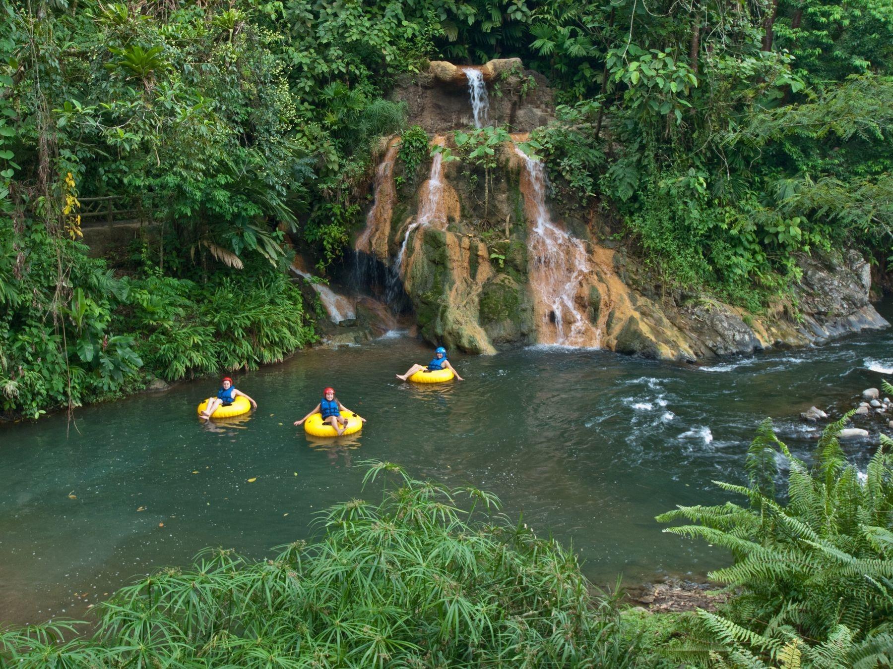 guest tubing near small waterfall