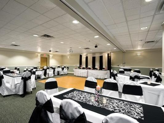 banquet room with dance floor and tables