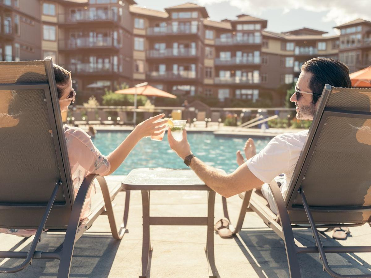 hotel lakeside pool couple