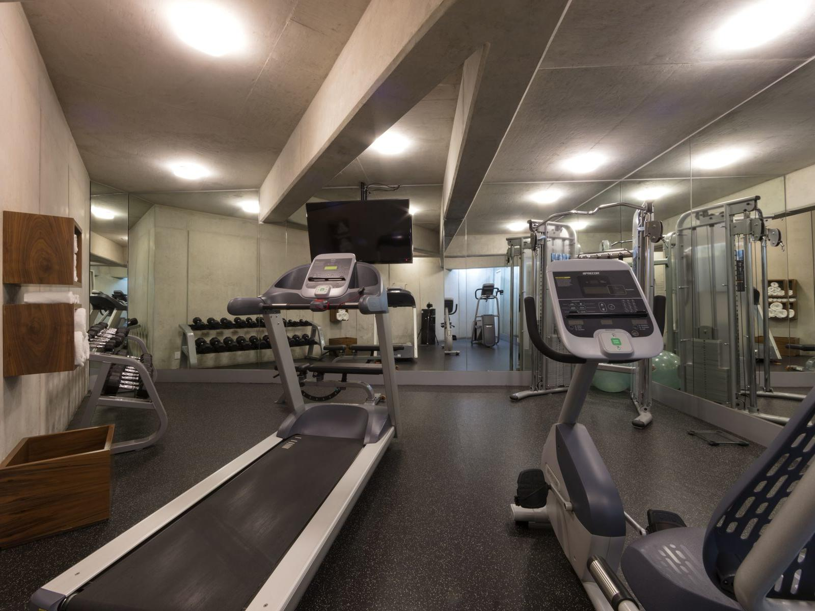 fitness center with treadmill and cardio machine