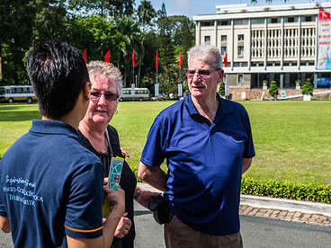 tourists following a tour outside the reunification palace