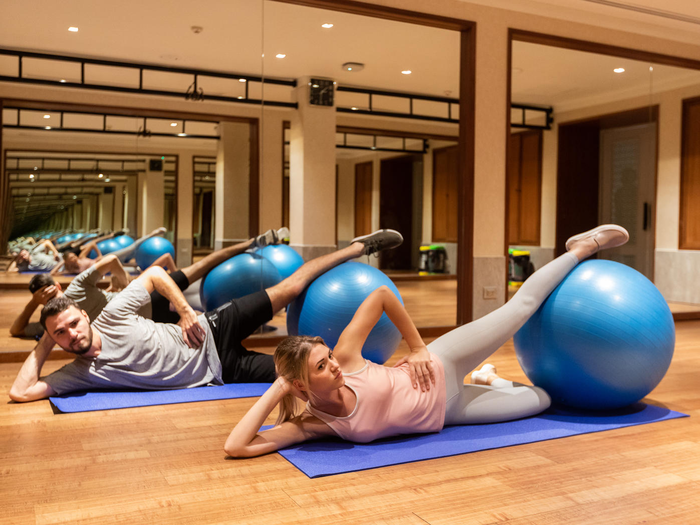 guests doing workout with an exercise ball