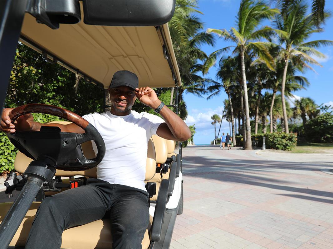 man driving golf cart