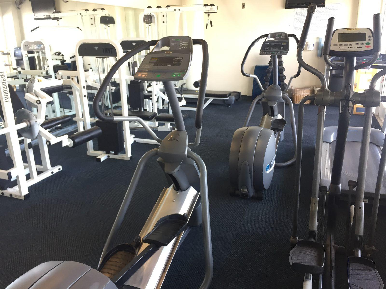 Exercise machines in the hotel gym at Bay Club Hotel
