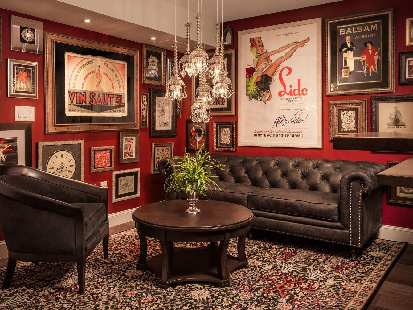 library lounge with black couches, carpet and red walls