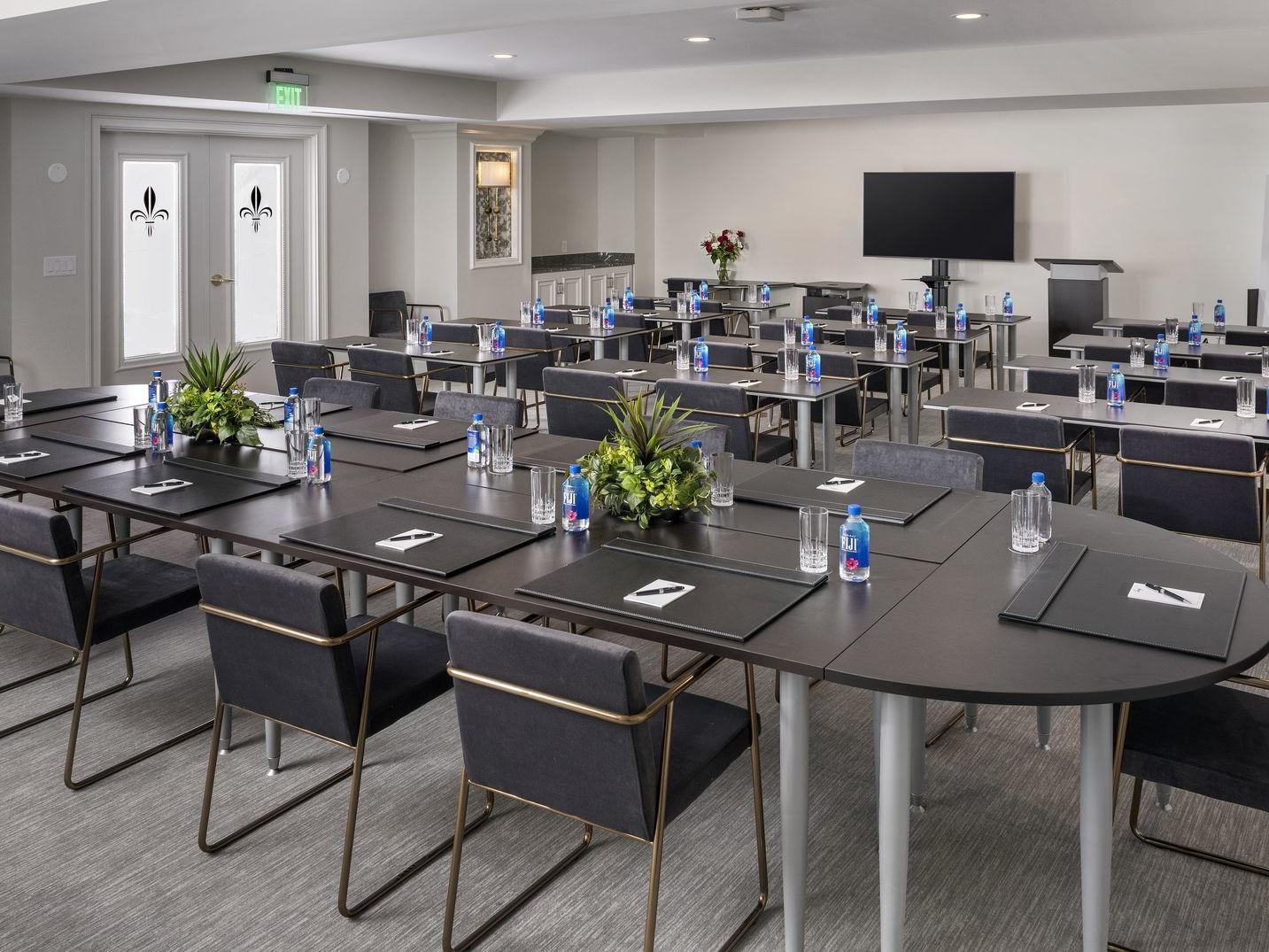 conference room with black tables and chairs
