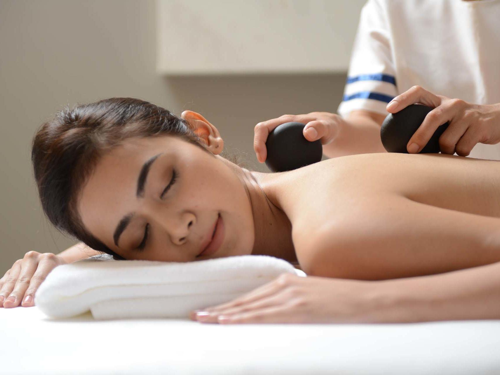 woman enjoying hot stone massage