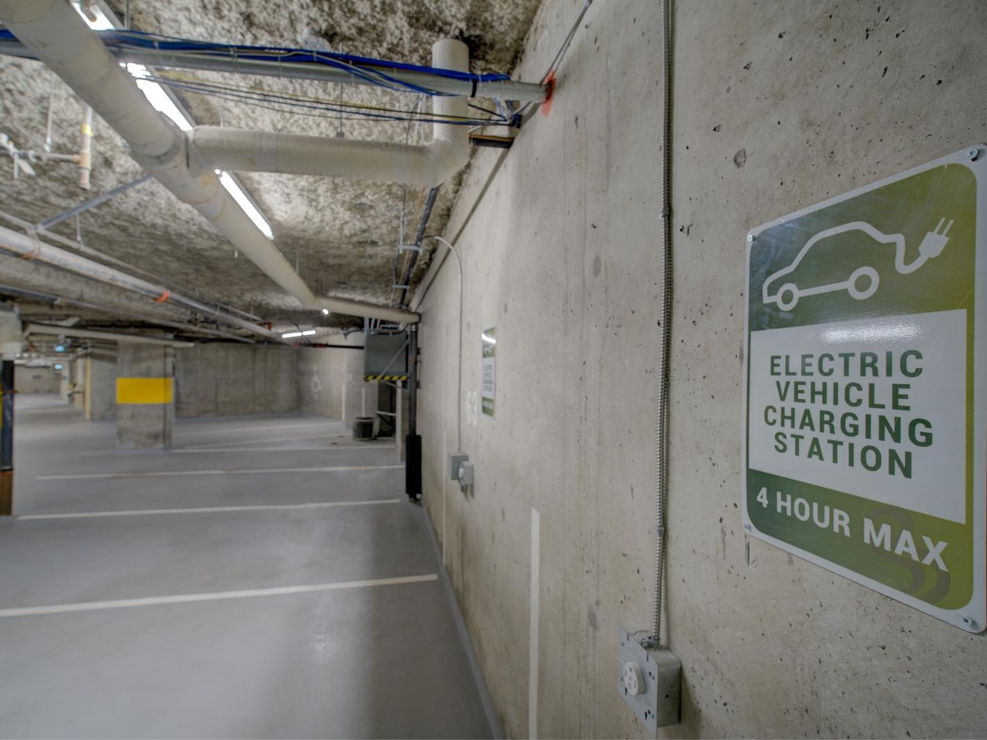 parking with sign for electric vehicles charging station