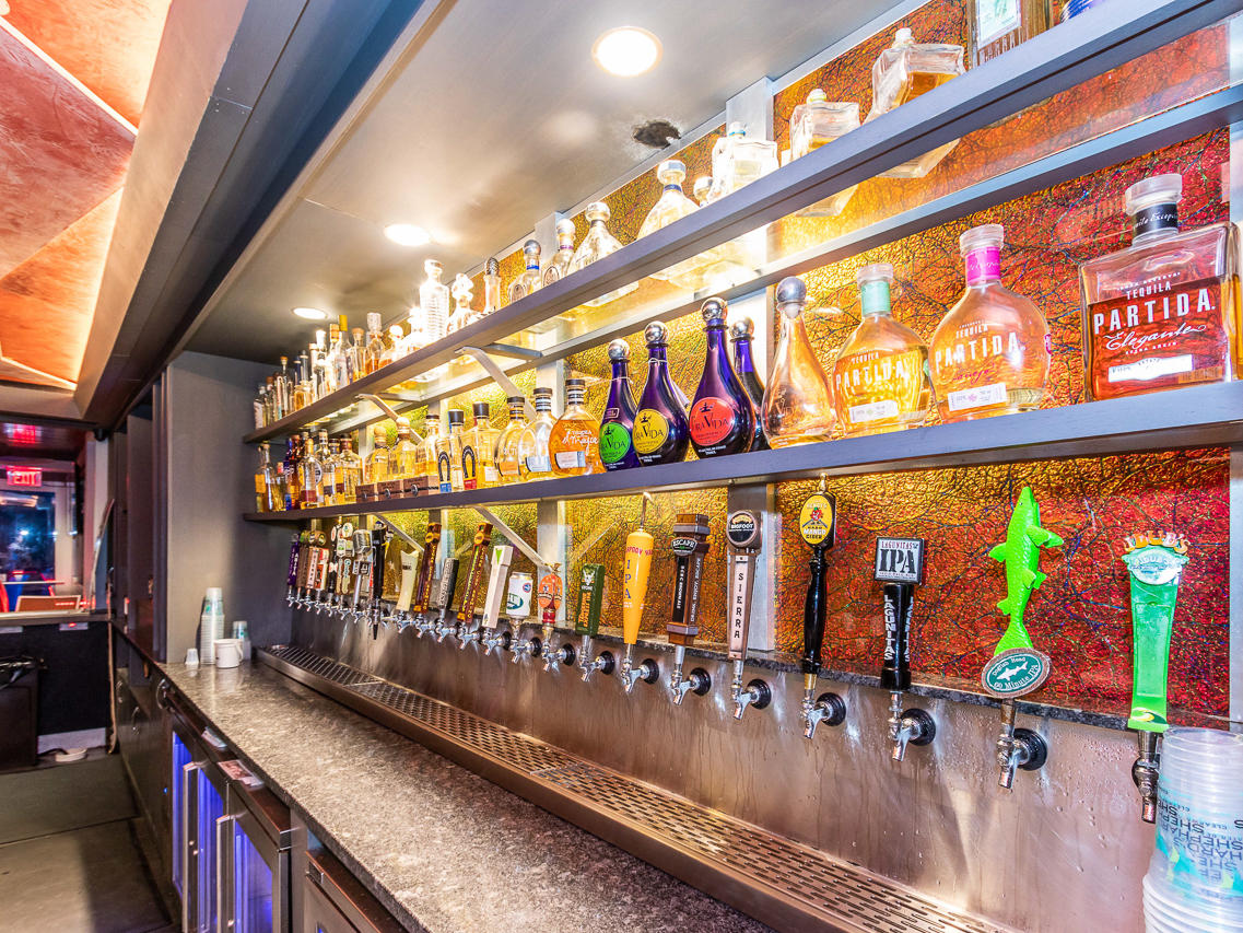 bar lined with draft beers