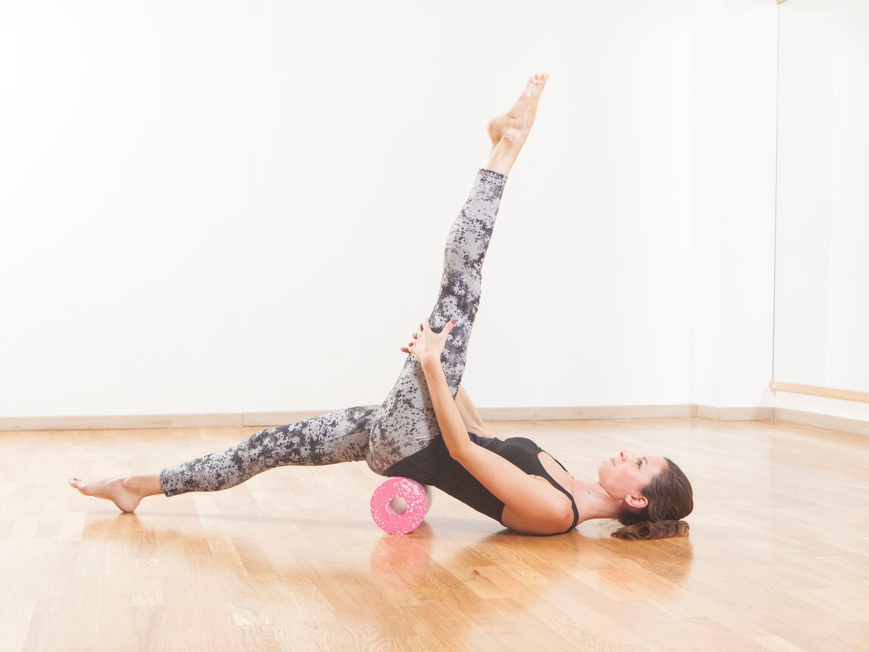 Women on foam roller doing yoga pose