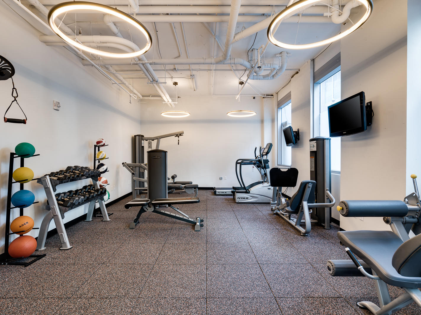 gym with fitness equipment and weights
