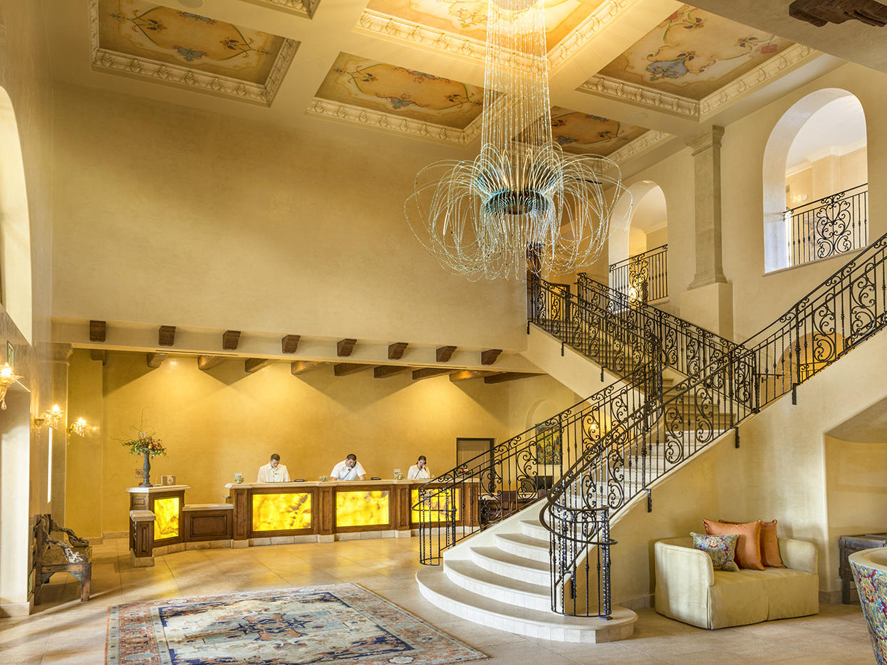Lobby with front desk and grand staircase