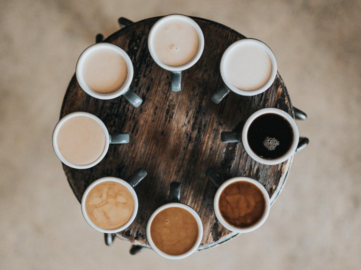 overhead shot of multiple cups of coffee in a circle